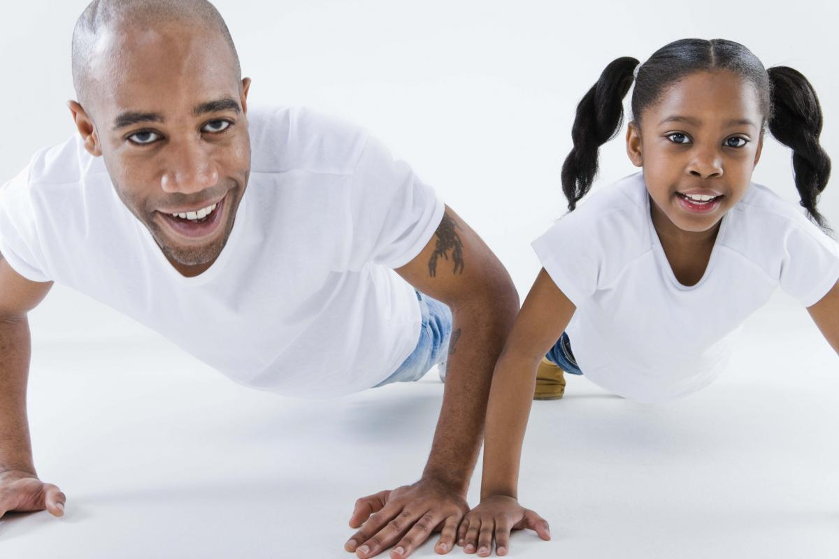 Father and Daughter doing pushups