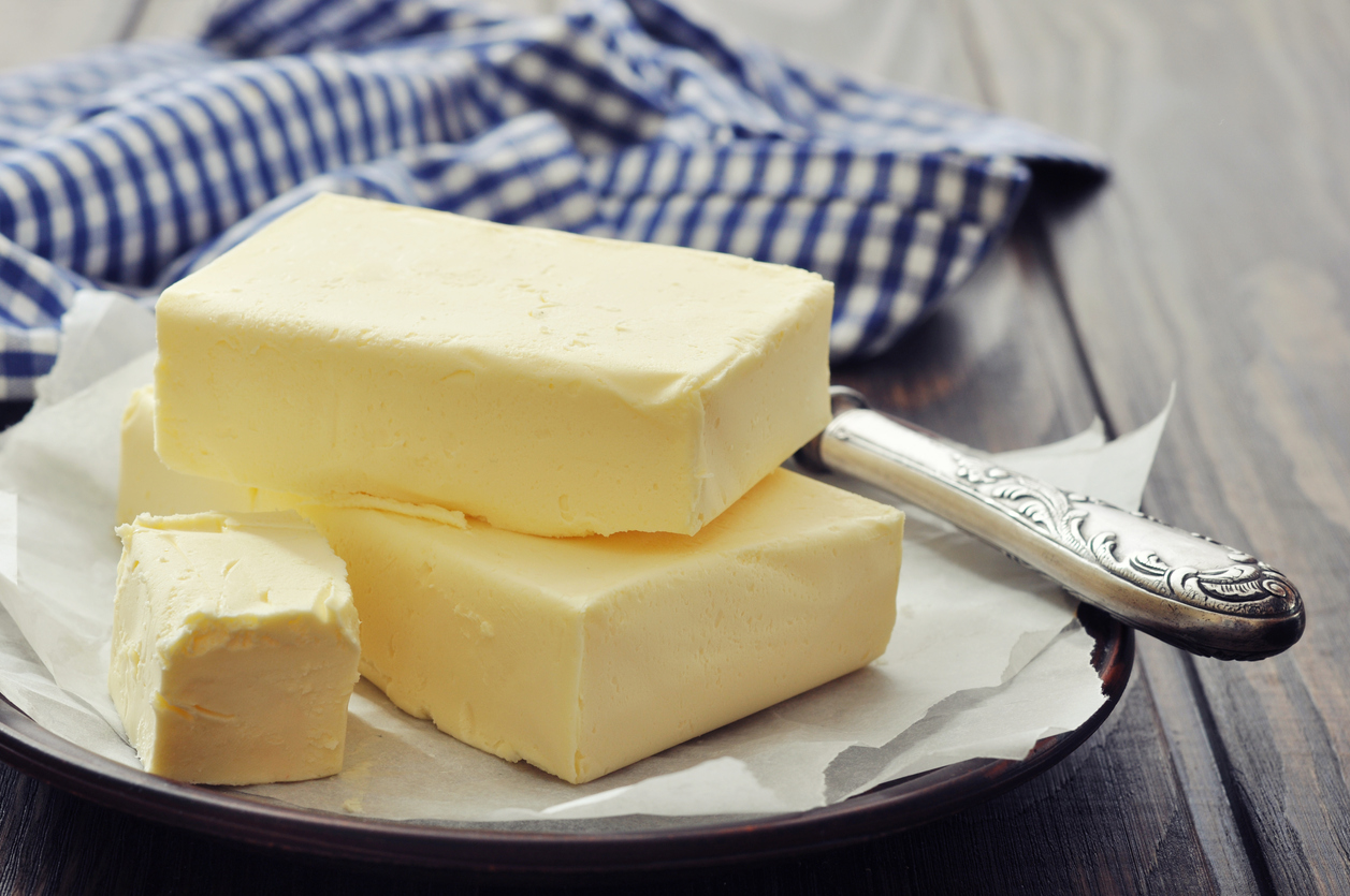image shows butter on a plate with a knife