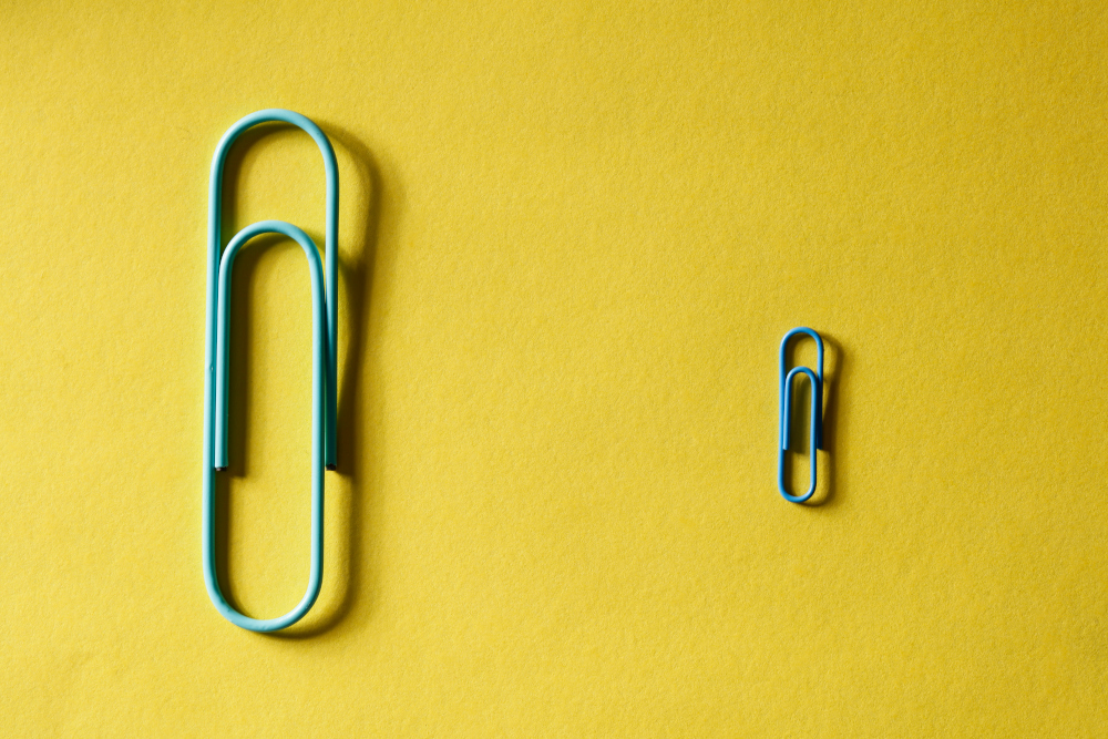 A large paper clip next to a smaller one
