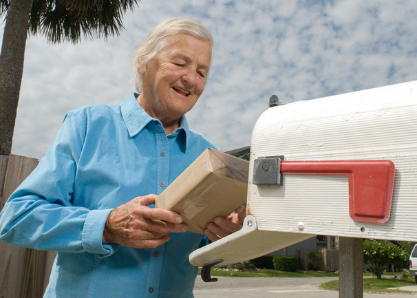 Senior citizen receives package in mail