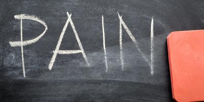 "Erasing the hand-written word ""pain"" on a blackboard"
