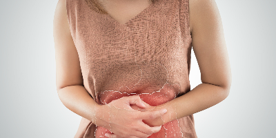 woman holding aching stomach