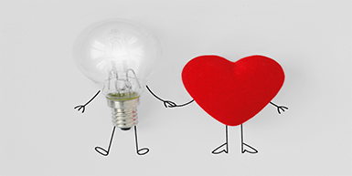 Light bulb and heart holding hands