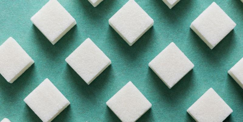 A picture of sugar cubes on a blue background.