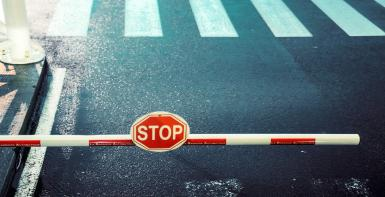 image shows a toll bar with a stop sign