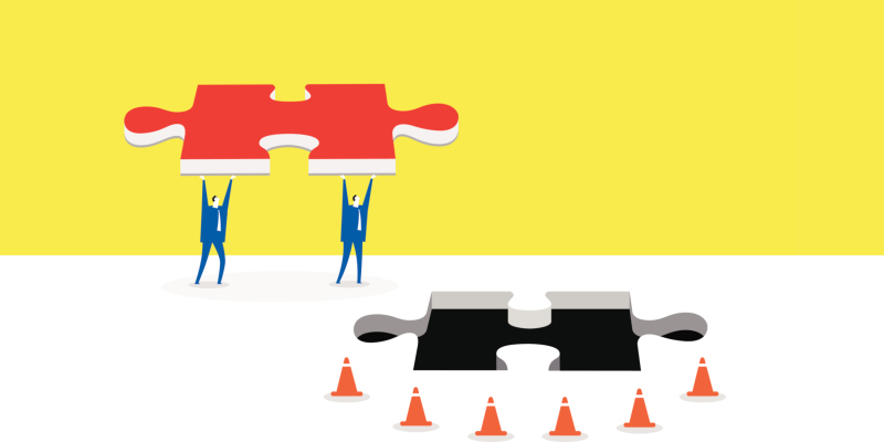 Illustration of people holding a puzzle piece that fits in a hole in the ground surrounded by orange cones