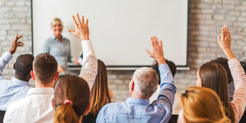 Raised Hands at Seminar