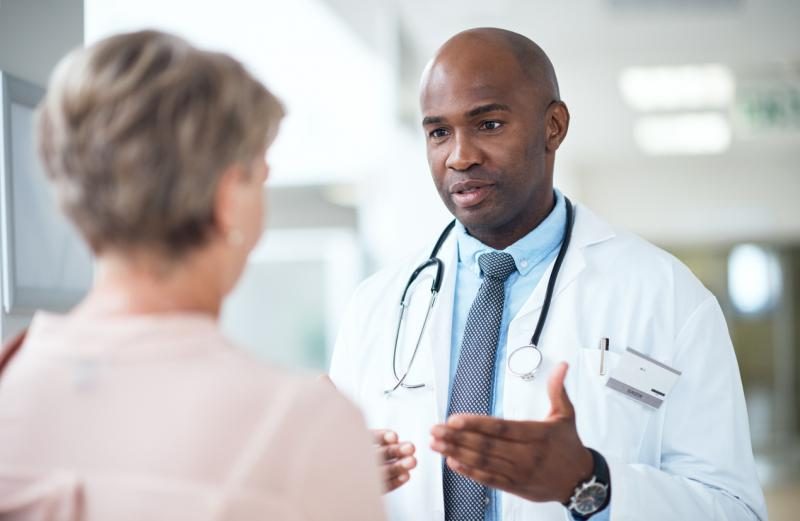 Image of a doctor and patient talking