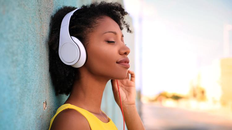 Woman listening to music on headphones