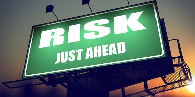 risk just ahead on green billboard