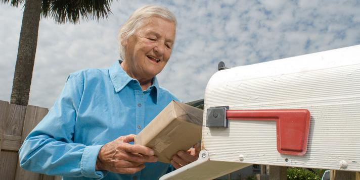 Senior citizen receives package in the mail